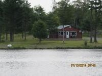 300 acres,cottage,half of a lake.
