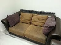 x 2 docaro sofas brown leather with tan and purple suede cushions. One is bit worn. Sell as pair