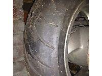 Honda Pantheon 125 rear wheel with tyre and brake disk