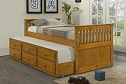 TRUNDLE BED WITH DRAWERS IN A HONEY FINISH *MATTRESSES SOLD SEPARATELY