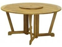 large wooden garden table with lazy susan