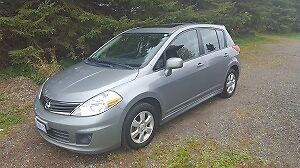 2010 Nissan Versa Hatchback with studded snow tires