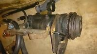 Fridigaire ac compressor with mounting brackets