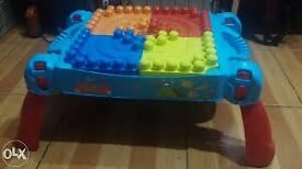 mega blocks table and box of blocks