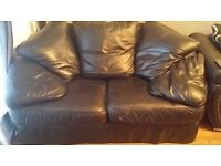 Black leather 2 seater sofa with detachable cushions.used