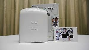 Fujifilm instaxSHARE brand new   . Your phone's pictures into prints.