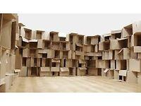 Medium/large flattened cardboard boxes for moving.