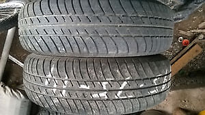 Two Motormaster 195 75 14 all season tires.
