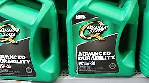Three 5L jugs of conventional 10W-30 motor oil  - new / unopened