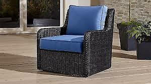 PAIR of Wicker swivel patio chairs with blue Sunbrella cushions