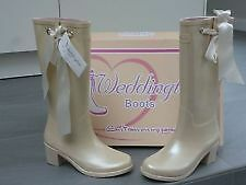 Cream Weddington Boot with ribbons.