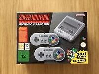 Super Nintendo Entertainment System SNES Classic Mini. New, never used. Unwanted gift.