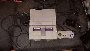 Super Nintendo avec manette et jeux