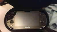PS Vita with 4GB & 16GB Memory Card + Controller Handle + Case