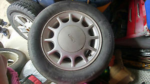 4 Aluminum Rims from a 92 Ford Taurus
