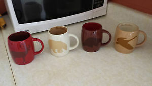 Set of 4 collectable Tim Horton mugs