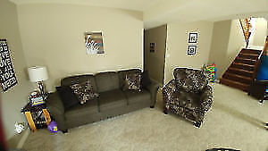 Couch and matching chair with throw pillows