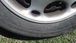 4 winter rims with excellent tires & 5 wheel discs off alero Belleville Belleville Area image 2