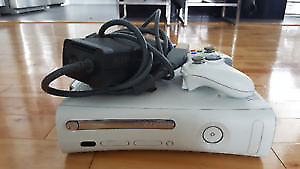 white xbox 360 and one controller the tray door sticks