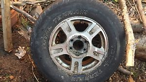 TIRE. one rim with tire. ford f150. expedition. 2003..