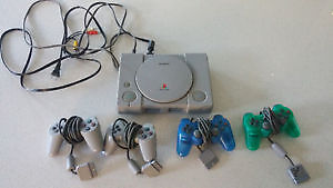 Play Station Console - with 4 controllers and 12 games