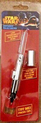 Star Wars Luke Skywalker light saber projection pen, glows blue.