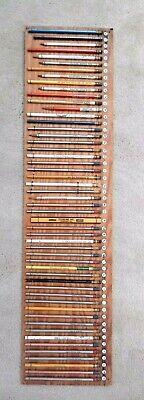 Lot of 53 vintage unused pencils with American advertisements on display board
