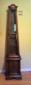 Small curio cabinet with glass shelves.