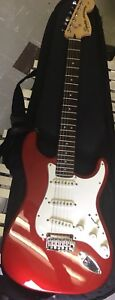 Red squire stratocaster by fender