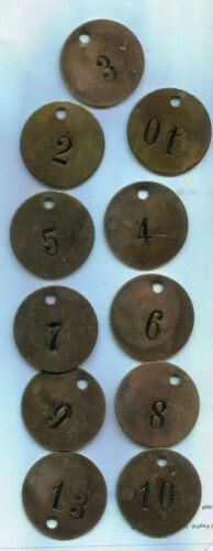 11 Vintage Brass Cow Tags numbered on both sides.