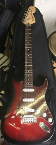 Red and black squire stratocaster by fender