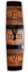 Barrel stave wall clock with Roman numerals. Made from retired oak wine barrel
