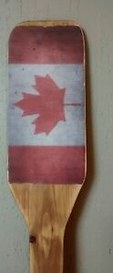hand crafted Canadiana paddle with maple leaf - each