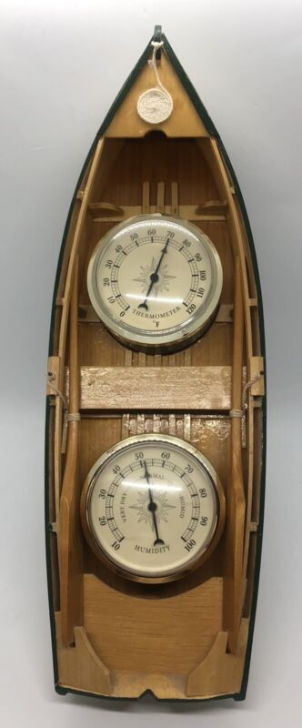 Springfield Thermometer And Humidity Gauges In A Wooden Boat With Paddles