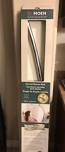 Brand new Moen curved shower rod