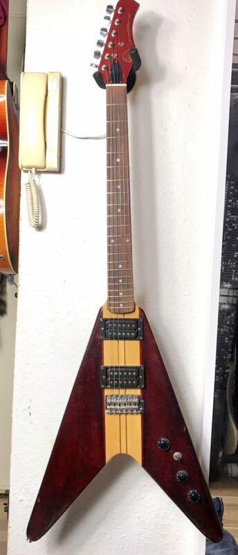 Hondo Deluxe 767 Flying V made in Korea . Vintage electric guitar 80's