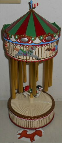 """AVON 1999 CHRISTMAS BATTERY OPERATED 17"""" HOLIDAY MUSICAL CHIMES CAROUSEL 12 SONG"""