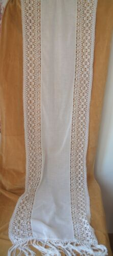A pair of antique French bobbin lace and muslin curtains