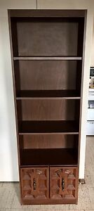 Brown wooden 4 shelves with cabinet
