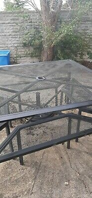 Wrought iron garden table and benches