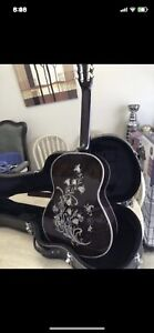 Beautiful pearl inlay acoustic guitar with hard case