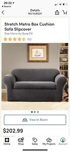 Sofa and Loveseat stretchable slip covers in grey fabric.