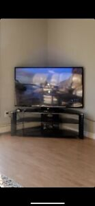 Glass tv stand with mounting plate
