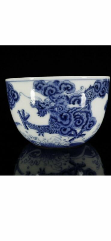 A Fine Blue And White Fish and Dragon Cup