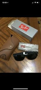 Black-framed black-tinted Ray-Ban wayfarer sunglasses with box