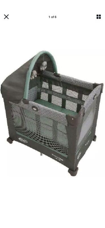 Graco Travel Lite Baby Versatile Crib & Portable Playard, Manor - Lightweight