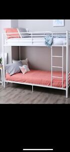 White steel twin on twin bunk bed