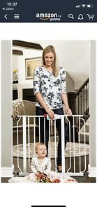 Two like-new Regalo  tension baby gates