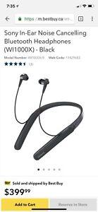 Black sony in-ear noise canceling bt headphones