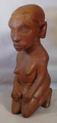 African Kneeling Girl Looking Grumpy  6 inches.16cm Country of origin unknown.